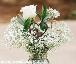 wedding flower arrangement with engraved wooden heart accent